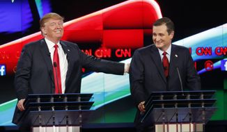 Donald Trump, left, jokes with Ted Cruz during the CNN Republican presidential debate at the Venetian Hotel & Casino on Tuesday, Dec. 15, 2015, in Las Vegas. (AP Photo/John Locher) ** FILE **