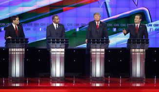 Ted Cruz, right, speaks during an exchange with Marco Rubio, left, as Ben Carson, second from left, and Donald Trump look on during the CNN Republican presidential debate at the Venetian Hotel & Casino on Tuesday, Dec. 15, 2015, in Las Vegas. (AP Photo/John Locher)