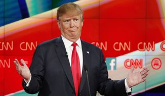 "GOP presidential contender Donald Trump laughed off the idea Tuesday that former Florida Gov. Jeb Bush is a ""tough guy"" in a testy exchange between the rivals in the GOP presidential debate. (Associated Press)"