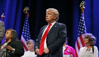 Republican presidential candidate Donald Trump attends a rally Monday, Dec. 14, 2015, in Las Vegas. (AP Photo/John Locher)