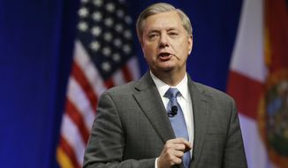 """Sen. [Rand] Paul and Sen. [Ted] Cruz are both isolationist,"" Sen. Lindsey Graham said, arguing that the United States should go after ISIS in Iraq and Syria and reinstate the NSA's controversial bulk metadata program. (Associated Press)"