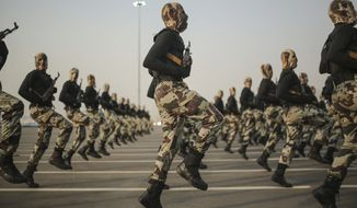 """FILE - In this Thursday, Sept. 17, 2015 file photo, Saudi security forces take part in a military parade in preparation for the annual Hajj pilgrimage in Mecca, Saudi Arabia. Saudi Arabia said Tuesday, Dec. 15, 2015 that 34 nations have agreed to form a new """"Islamic military alliance"""" to fight terrorism with a joint operations center based in the kingdom's capital, Riyadh.(AP Photo/Mosa'ab Elshamy, File)"""