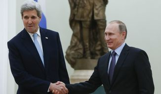 Russian President Vladimir Putin, right, shakes hands with U.S. Secretary of State John Kerry during their meeting in the Kremlin in Moscow, Russia, Tuesday, Dec. 15, 2015. The United States and Russia need to find common ground to end Syria's civil war and restore stability in eastern Ukraine, U.S. Secretary of State John Kerry said Tuesday, as he met with Russian President Vladimir Putin to try to narrow gaps in the countries' approaches to the crises.  (Sergei Karpukhin/Pool Photo via AP)