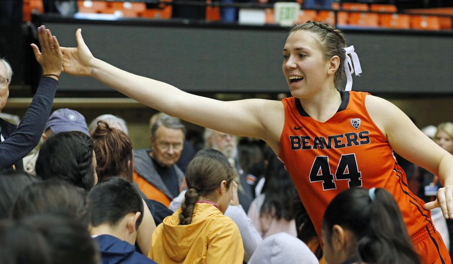 Oregon State's Ruth Hamblin high fives fans after Oregon State defeated CSU Bakersfield 75-51 in an NCAA college basketball game, in Corvallis, Ore., on Tuesday, Dec. 15, 2015. (AP Photo/Timothy J. Gonzalez)