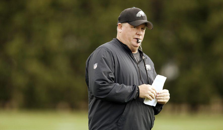 Philadelphia Eagles head coach Chip Kelly directs his team at the NFL football team's practice facility, Tuesday, Dec. 15, 2015, in Philadelphia. (AP Photo/Matt Rourke)