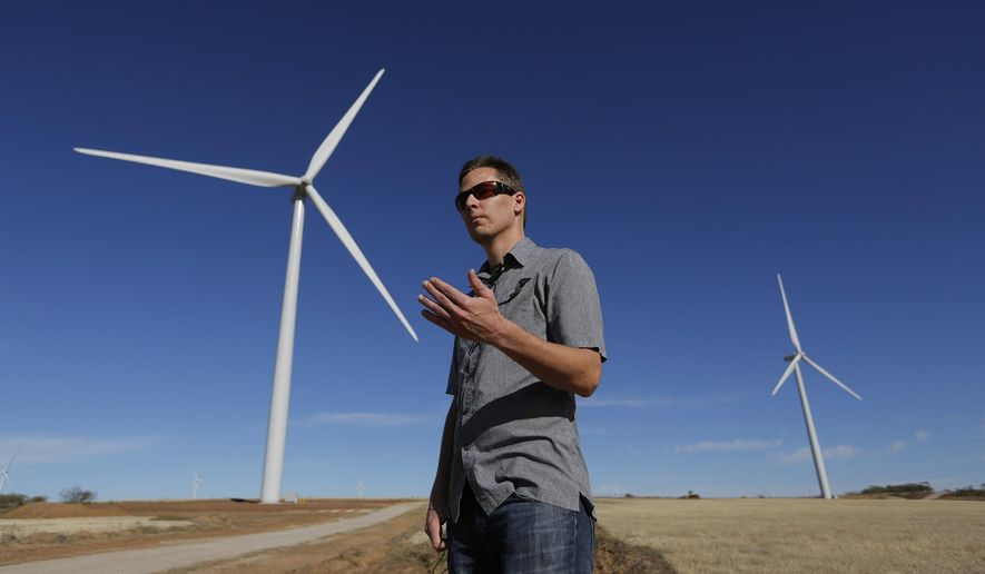 Jimmy Horn talks about wind farms near turbines on his ranch in a Wednesday, Dec. 9, 2015 photo, in Windthorst, Texas. His company, Horn Wind Energy, helped develop the new 119-turbine, 204-megawatt Shannon Wind Farm, now operated and partly owned by Alterra Power Corp. of Canada. The idea for two new wind farms originated with landowners, Horn said. (Rodger Mallison/Star-Telegram via AP)  MAGS OUT; (FORT WORTH WEEKLY, 360 WEST); INTERNET OUT; MANDATORY CREDIT