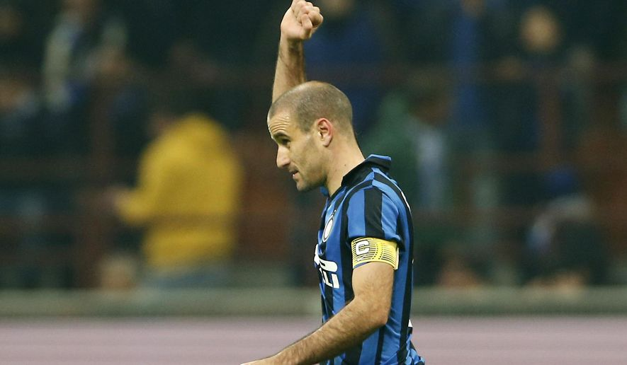 Inter Milan's Rodrigo Palacio celebrates after scoring during the Italian Cup soccer match between Inter Milan and Cagliari at the San Siro stadium in Milan, Italy, Tuesday, Dec. 15, 2015. (AP Photo/Antonio Calanni)