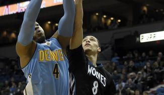 Denver Nuggets guard Randy Foye (4) grabs a rebound against Minnesota Timberwolves guard Zach LaVine (8) during the first quarter of an NBA basketball game Tuesday, Dec. 15, 2015, in Minneapolis. (AP Photo/Hannah Foslien)