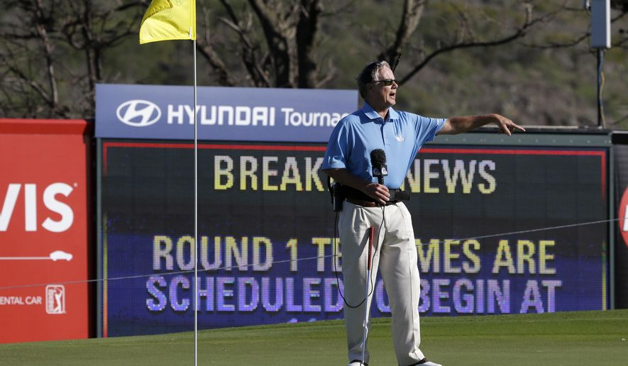 FILE - This Jan. 6, 2013, file photo shows broadcast analyst Mark Rolfing talking about the wind from the 10th green before the first round at the Tournament of Champions PGA golf tournament, in Kapalua, Hawaii. Five months after he was diagnosed with a rare form of cancer, Mark Rolfing returns to his broadcasting duties for Golf Channel on Jan. 7 for the Hyundai Tournament of Champions in Hawaii.  (AP Photo/Elaine Thompson, File)