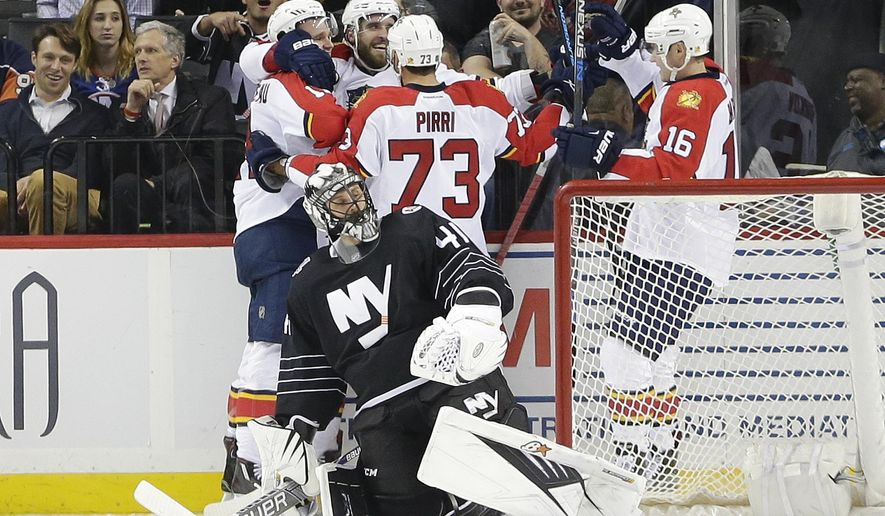New York Islanders goalie Jaroslav Halak (41) reacts as the Florida Panthers celebrate a goal by Aleksander Barkov (16) during the second period of an NHL hockey game Tuesday, Dec. 15, 2015, in New York. (AP Photo/Frank Franklin II)