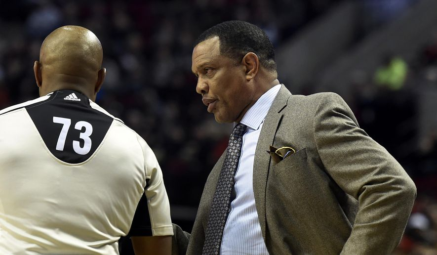 New Orleans Pelicans head coach Alvin Gentry speaks with referee Tre Maddox (73) during the first half of an NBA basketball game in Portland, Ore., Monday, Dec. 14, 2015. (AP Photo/Steve Dykes)