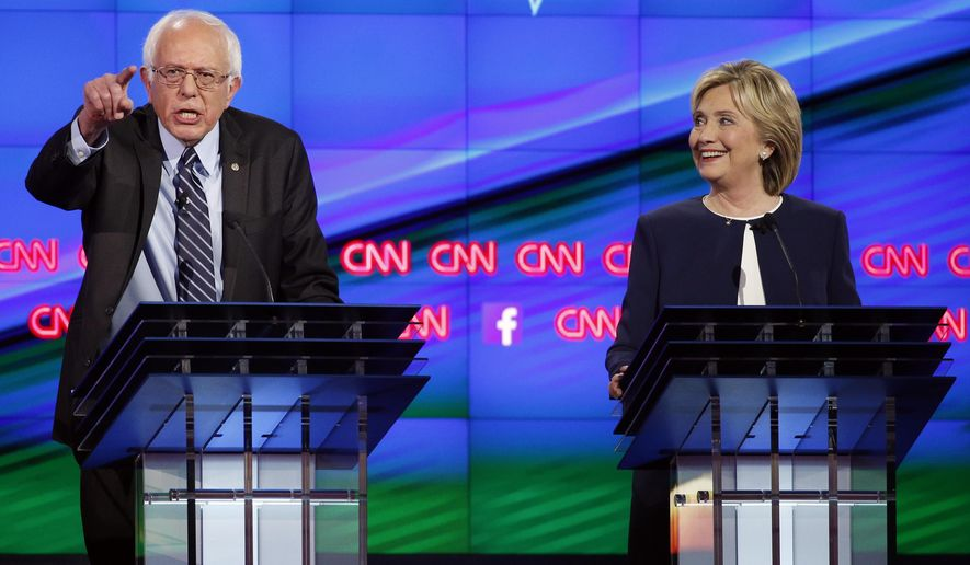 FILE - In this Tuesday, Oct. 13, 2015, file photo, Sen. Bernie Sanders, of Vermont, left, speaks as Hillary Clinton looks on during the CNN Democratic presidential debate in Las Vegas. Sanders is on the list of the most notable quotes of 2015, as compiled by a Yale Law School librarian. (AP Photo/John Locher, File)