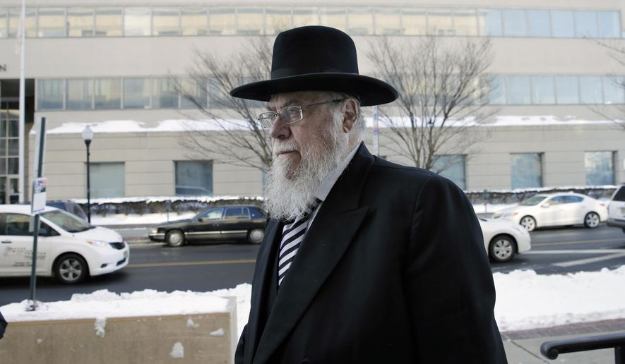 FILE - In a Wednesday, Feb. 18, 2015 file photo, Rabbi Mendel Epstein, right, arrives for his trial at federal court in Trenton, N.J. Epstein, who admitted to a judge he got caught up in his tough-guy image while leading a ring that coerced religious divorces from recalcitrant men was sentenced Tuesday, Dec. 15, 2015, in New Jersey to a decade in prison. He was convicted in April 2015 of conspiracy to commit kidnapping after prosecutors said he led a team that used brutal methods and tools to torture the men into granting a divorce. (AP Photo/Mel Evans, File)