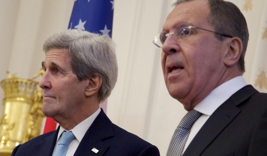 U.S. Secretary of State John Kerry, left, looks on as Russian Foreign Minister Sergey Lavrov speaks during their meeting in Moscow Tuesday, Dec. 15, 2015. Kerry arrived in Moscow to hold talks with Lavrov and Russian President Vladimir Putin. (AP Photo/Ivan Sekretarev)