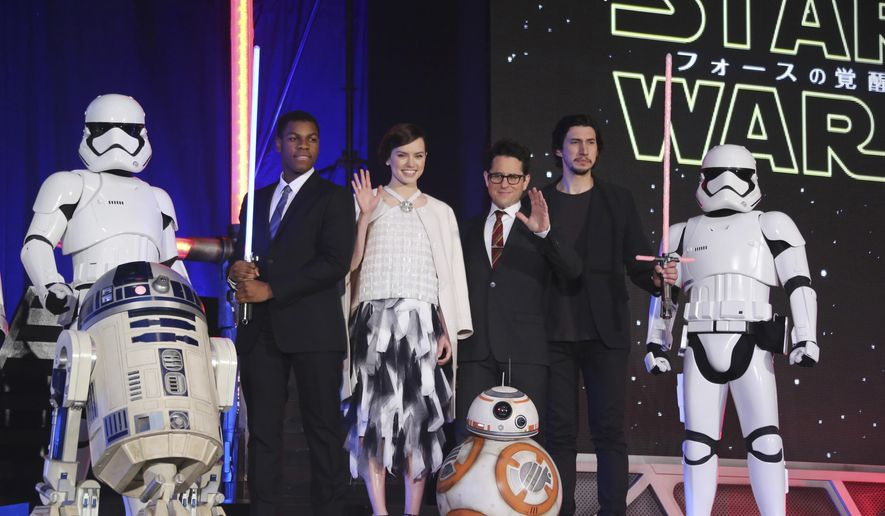 "In this Thursday, Dec. 10, 2015 file photo, director J.J. Abrams, third right, and actors, John Boyega, second left, Daisy Ridley, third left, and Adam Driver, second right, pose for photos during the Japan Premiere of their latest film ""Star Wars: The Force Awakens"" in Tokyo. (AP Photo/Koji Sasahara, File)"