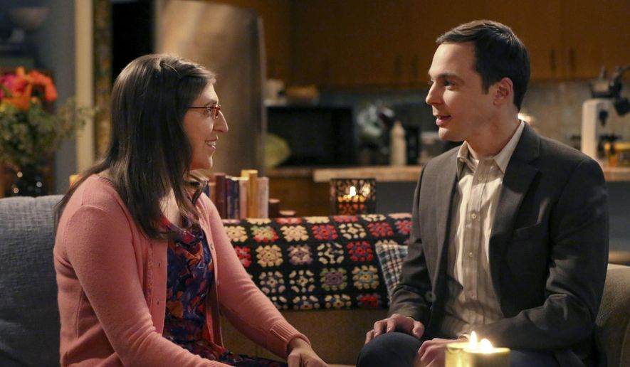 """This image released by CBS shows Mayim Bialik, left, portrays Amy, and Jim Parsons portrays Sheldon in a scene from """"The Big Bang Theory."""" (Michael Yarish/CBS via AP)"""