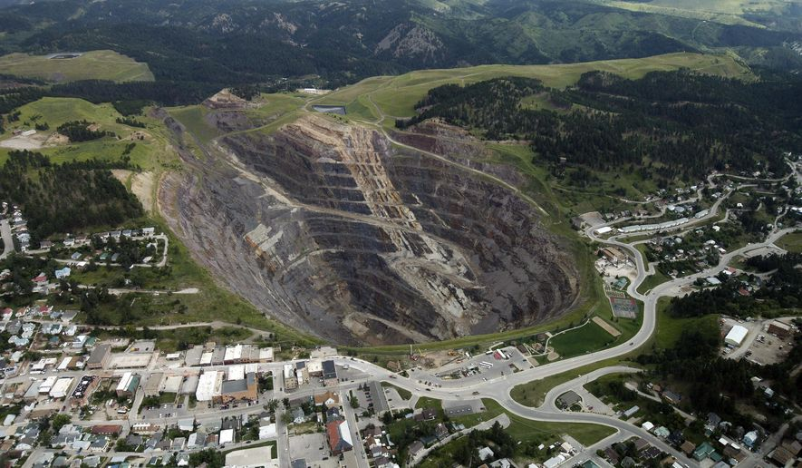 Two brothers are proposing to build a zip line to run across the Homestake Open Cut in Lead S.D., shown in this August, 2014, aerial photo. The line would be nearly 3,000 feet long and almost 1,200 height at it's tallest point. But Lead city officials and the pit's owner have put the brakes on the project for now. (Chris Huber/Rapid City Journal via AP) TV OUT; MANDATORY CREDIT