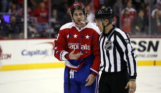 Washington Capitals right wing Tom Wilson (43) is escorted off the ice by linesman Bryan Pancich (94) after a penalty in the third period of an NHL hockey game against the Ottawa Senators, Wednesday, Dec. 16, 2015, in Washington. The Capitals won 2-1. (AP Photo/Alex Brandon)