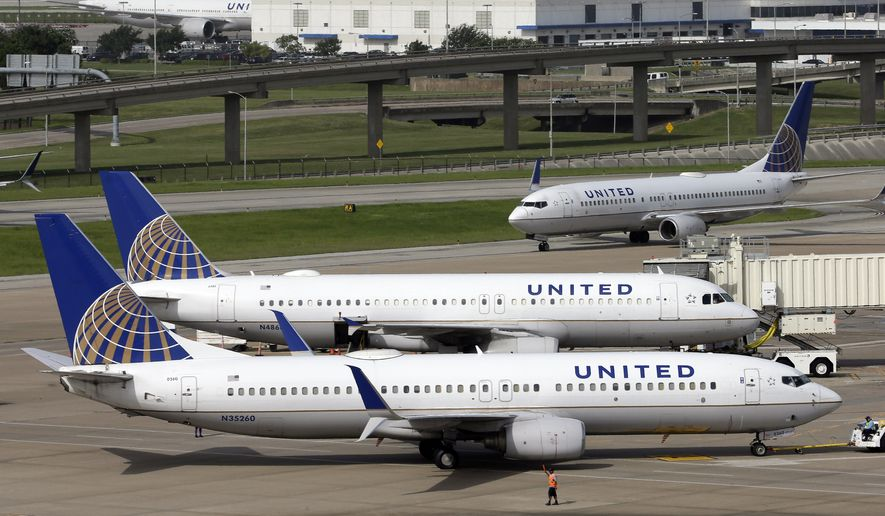A United Airlines plane, front, is pushed back from a gate at George Bush Intercontinental Airport in Houston. (Associated Press)