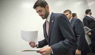 House Speaker Paul Ryan of Wis. looks over his notes before a news conference on Capitol Hill in Washington, Wednesday, Dec. 16, 2015,  following a closed-door session with House Republicans as lawmakers work to complete end-of-the-year business and pass a comprehensive spending bill.  Congressional leaders girded to push a Christmas compromise on tax cuts and spending through the House and Senate by week's end after Republicans and Democrats reached agreement on a legislative package extending dozens of tax breaks for businesses and families and financing 2016 government operations.  (AP Photo/J. Scott Applewhite)