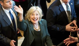 Democratic presidential candidate Hillary Clinton waves to supporters at a campaign event, Wednesday, Dec. 16, 2015, at Sokol Auditorium in Omaha, Neb. (Kristin Streff/The Journal-Star via AP) ** FILE **