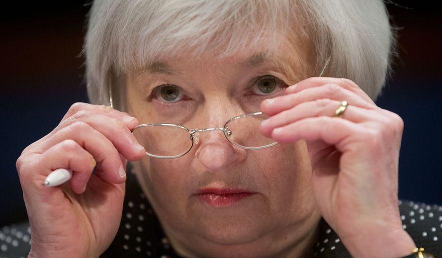 "In this Wednesday, Feb. 25, 2015, file photo, Federal Reserve Chair Janet Yellen removes her glasses as she testifies on Capitol Hill in Washington, before the House Financial Services Committee hearing: ""Monetary Policy and the State of the Economy."" A rate increase is expected when the Federal Reserve ends its latest meeting Wednesday, Dec. 16, 2015. It would be the first rate hike in more than nine years. And it would raise the Fed's benchmark rate from a record low near zero, where it's been for seven years. (AP Photo/Pablo Martinez Monsivais, File)"