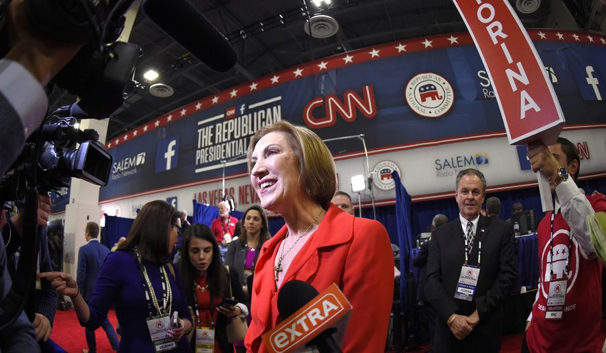Carly Fiorina talks to the press in the spin room following the CNN Republican presidential debate at the Venetian Hotel & Casino on Tuesday, Dec. 15, 2015, in Las Vegas. (AP Photo/Mark J. Terrill)