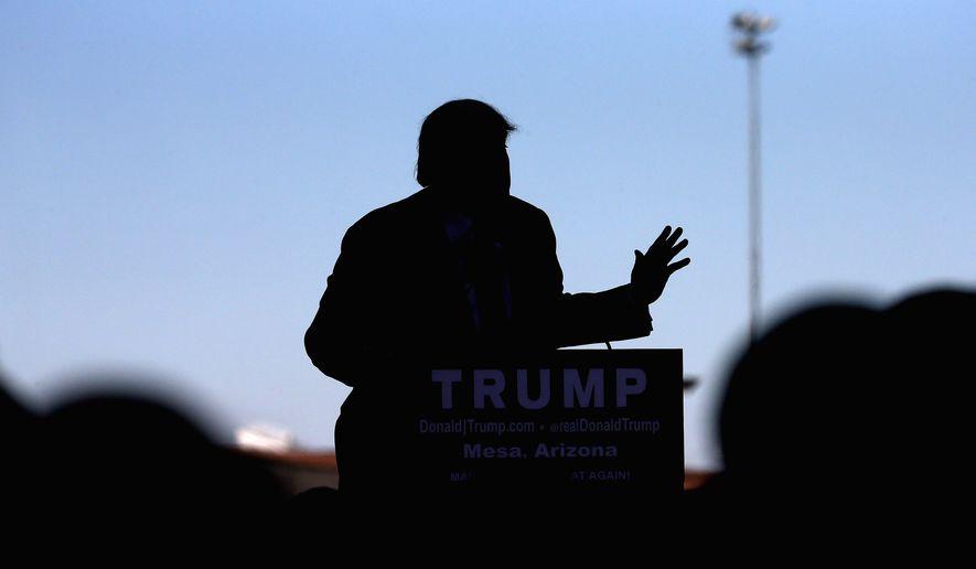 Republican presidential candidate Donald Trump speaks at a campaign rally, Wednesday, Dec. 16, 2015, in Mesa, Ariz. (AP Photo/Matt York)