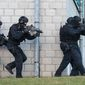 "Members of the new unit ""BFE+"" of the German federal police exercise in Ahrensfelde, Germany, Wednesday Dec. 16,  2015. Germany on Wednesday introduced a new police unit that officials said will be better armed, outfitted and trained to deal with terrorism, based on an analysis of the country's security in the wake of deadly attacks in Paris earlier this year. (Bernd von Jutrczenka/dpa via AP)"