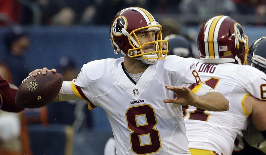 FILE - In this Dec. 13, 2015 file photo, Washington Redskins quarterback Kirk Cousins (8) throws during the second half of an NFL football game against the Chicago Bears in Chicago. Publicly, anyway, the Washington Redskins have not made clear whether they envision Kirk Cousins as their quarterback of the future. A look at his statistics, though, shows that Cousins is compiling numbers that make him look good when compared to Redskins QBs of the past. (AP Photo/Nam Y. Huh, File)