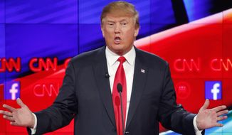Donald Trump makes a point during the CNN Republican presidential debate at the Venetian Hotel & Casino in Las Vegas, in this Dec. 15, 2015, photo. During the debate, Trump stated that since the extremist Islamic State group is using the Internet to recruit; the tech industry needs to find a way to stop them from doing that. (AP Photo/John Locher, File)