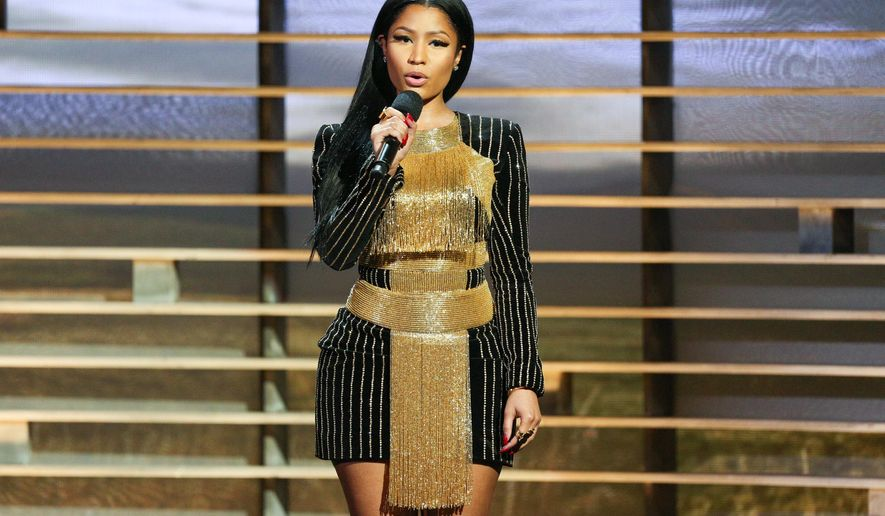 FILE - In this Nov. 18, 2015 file photo, Nicki Minaj speaks at Shining a Light: A Concert for Progress on Race in America in Los Angeles. Rights groups are lobbying Minaj to cancel her upcoming concert in Angola, a southern African country often criticized for human rights abuses and corruption.  She is set to perform in the capital, Luanda, in a holiday season concert organized by Angolan mobile phone company Unitel, according to local media reports. (Photo by Rich Fury/Invision/AP, FIle)