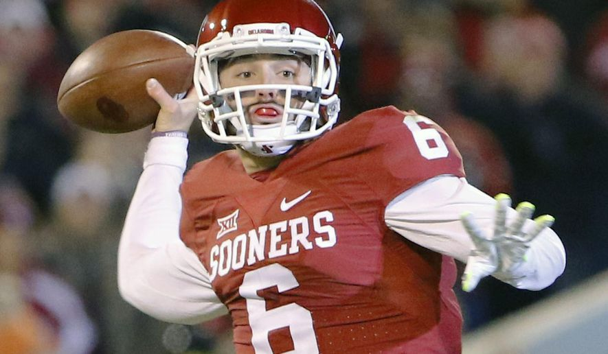 FILE - In this Nov. 21, 2015, file photo, Oklahoma quarterback Baker Mayfield (6) looks to pass against TCU during the first quarter of an NCAA college football game in Norman, Okla. Oklahoma quarterback Baker Mayfield is the unanimous pick as the Big 12 offensive player of the year and one of seven Sooners on The Associated Press All-Big 12 first team. (AP Photo/Alonzo Adams, File)
