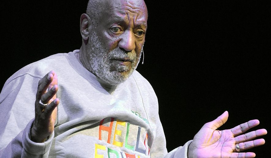 FILE - In this Friday, Nov. 21, 2014, file photo, comedian Bill Cosby performs at the Maxwell C. King Center for the Performing Arts, in Melbourne, Fla. On Monday, Dec. 14, 2015, Cosby filed counterclaims in federal court in Springfield, Mass., against seven women who are suing him for defamation, accusing them of making false accusations of sexual misconduct for financial gain. That same day,  Boston University trustees voted to revoke an honorary degree awarded to Cosby during its May 2014 commencement. (AP Photo/Phelan M. Ebenhack, File)