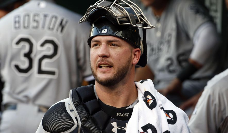 FILE - In this Monday, June 15, 2015 file photo, Chicago White Sox catcher Tyler Flowers walks through the dugout before a baseball game against the Pittsburgh Pirates in Pittsburgh. The Atlanta Braves have agreed to terms on a two-year, $5.3 million deal with free-agent catcher Tyler Flowers, Wednesday, Dec. 16, 2015  (AP Photo/Gene J. Puskar, File)