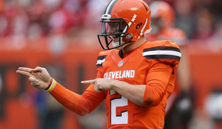 FILE - In this Dec. 13, 2015, file photo, Cleveland Browns quarterback Johnny Manziel (2) gestures during the first half of an NFL game against the San Francisco 49ers, in Cleveland. Russell Wilson has it all put together. Johnny Manziel has been nothing but chaos since entering the NFL. The two players with similar football skills meet for the first time on Sunday.(AP Photo/Ron Schwane, File)