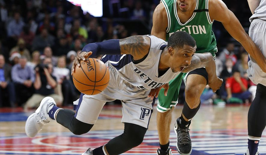 Detroit Pistons guard Kentavious Caldwell-Pope (5) drives on Boston Celtics guard Avery Bradley (0) during the second half of an NBA basketball game Wednesday, Dec. 16, 2015, in Auburn Hills, Mich. (AP Photo/Paul Sancya)