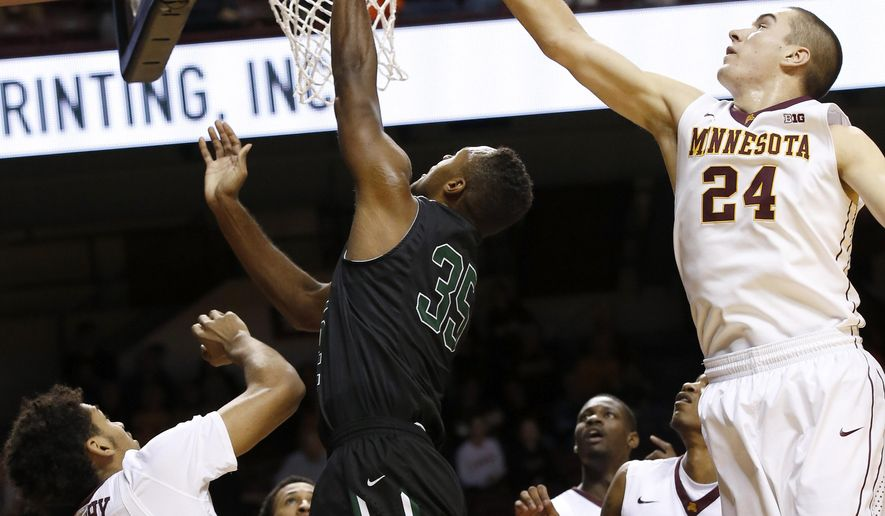 Minnesota forward Joey King (24) reaches to block a shot by Chicago State forward Devon Friend (35) as Minnesota forward Jordan Murphy (3) adds pressure during the first half of an NCAA college basketball game in Minneapolis, Wednesday, Dec. 16, 2015. (AP Photo/Ann Heisenfelt)