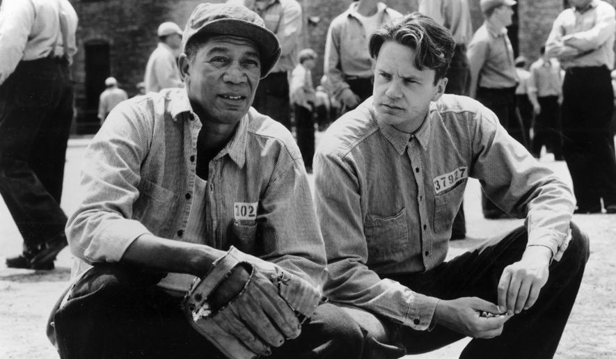 "In this photo provided by Courtesy Castle Rock Entertainment via the Library of Congress, a scene from the movie Shawshank Redemption, featuring inmates Red (Morgan Freeman), left, and Andy (Tim Robbins) share a quiet moment in the prison yard at Shawshank. It's a bro-centric year for movies added to the prestigious National Film Registry. Two of the most popular male-bonding movies of all time, ""Ghostbusters"" and ""The Shawshank Redemption,"" are being added to the collection of films preserved by the Library of Congress, the library announced Wednesday. (Courtesy Castle Rock Entertainment/Library of Congress via AP)"