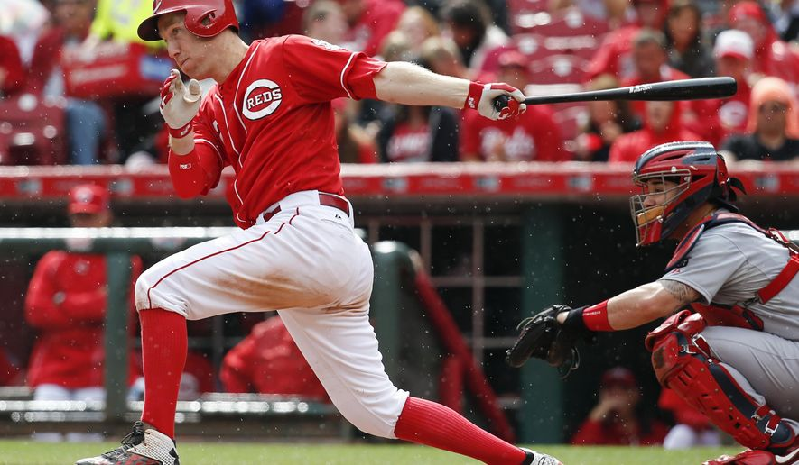 FILE - In this Sept. 12, 2015, file photo, Cincinnati Reds' Todd Frazier hits a single in the sixth inning of a baseball game against the St. Louis Cardinals, in Cincinnati. All-Star third baseman Todd Frazier has been dealt from the Reds to the Chicago White Sox as part of a three-team, seven-player trade that also includes the Los Angeles Dodgers. (AP Photo/John Minchillo, File)