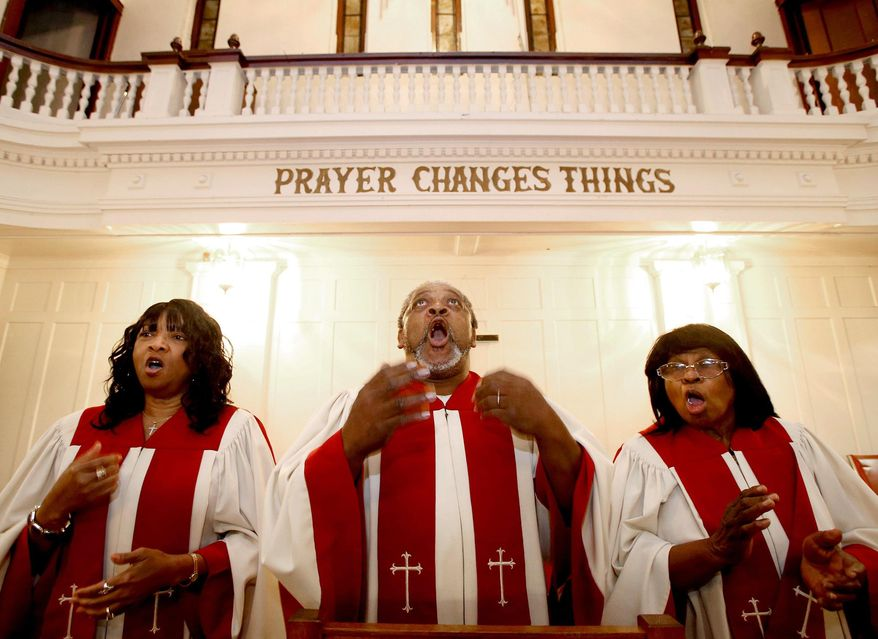 In this Thursday, Dec. 10, 2015 photo, members of the St. James Methodist Church's choir Harolyn Brooks, from left, Joe Humphrey and Dorothy Seale rehearse for Sunday's service in Waco, Texas. The church, founded by slaves and considered one of the oldest black churches in town, is down to 20 or 30 members and maybe forced to close while members look for a smaller building. (Jerry Larson/Waco Tribune Herald via AP) MANDATORY CREDIT