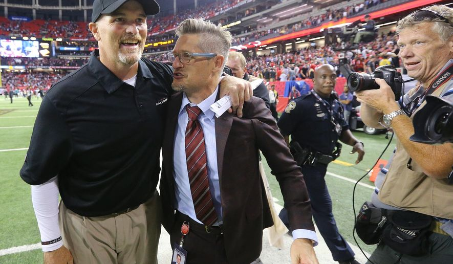 FILE - In this Monday, Sept. 14, 2015,  file photo, Atlanta Falcons head coach Dan Quinn, left,  celebrates winning his first NFL game as a head coach with general manager Thomas Dimitroff after an NFL football game, in Atlanta. No one is facing the heat more than general manager Thomas Dimitroff, who could be in his final weeks on the job after once being hailed as a rising star in the NFL executive ranks.  (Curtis Compton/Atlanta-Journal Constitution via AP, File)