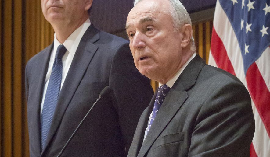 NYPD Commissioner William Bratton, right, and FBI Director James Comey, left, hold a press conference after addressing the NYPD Shield Conference at police headquarters, Wednesday, Dec. 16, 2015, in New York. (AP Photo/Bebeto Matthews)