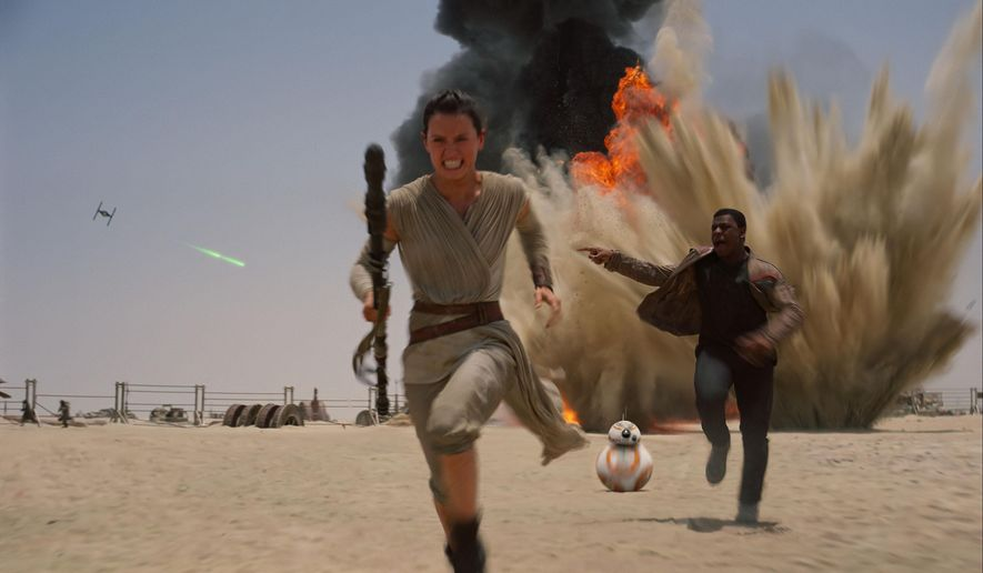 "This photo provided by Disney shows Daisey Ridley as Rey, left, and John Boyega as Finn, in a scene from the new film, ""Star Wars: The Force Awakens,"" directed by J.J. Abrams. The movie releases in the U.S. on Dec. 18, 2015. (Film Frame/Disney/Copyright Lucasfilm 2015 via AP)"