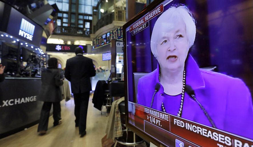 Federal Reserve Chair Janet Yellen's Washington news conference is shown on a television screen on the floor of the New York Stock Exchange, Wednesday, Dec. 16, 2015. The Fed's move to lift its key rate by a quarter-point to a range of 0.25 percent to 0.5 percent ends an extraordinary seven-year period of near-zero rates that began at the depths of the 2008 financial crisis. (AP Photo/Richard Drew)