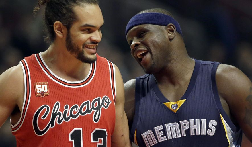 Memphis Grizzlies forward Zach Randolph, right, smiles as he talks with Chicago Bulls forward Joakim Noah during the first half of an NBA basketball game on Wednesday, Dec. 16, 2015, in Chicago. (AP Photo/Nam Y. Huh)