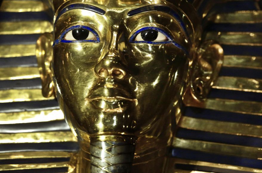 The gold mask of King Tutankhamun is displayed in its glass case, in the Egyptian Museum near Tahrir Square, in Cairo, Wednesday, Dec. 16, 2015. Antiquities Minister Mamdouh el-Damaty says the famed golden burial mask  has been fixed, over a year after the beard was accidentally knocked off and hastily glued back with epoxy. A German-Egyptian team began the restoration work in October. (AP Photo/Nariman El-Mofty)