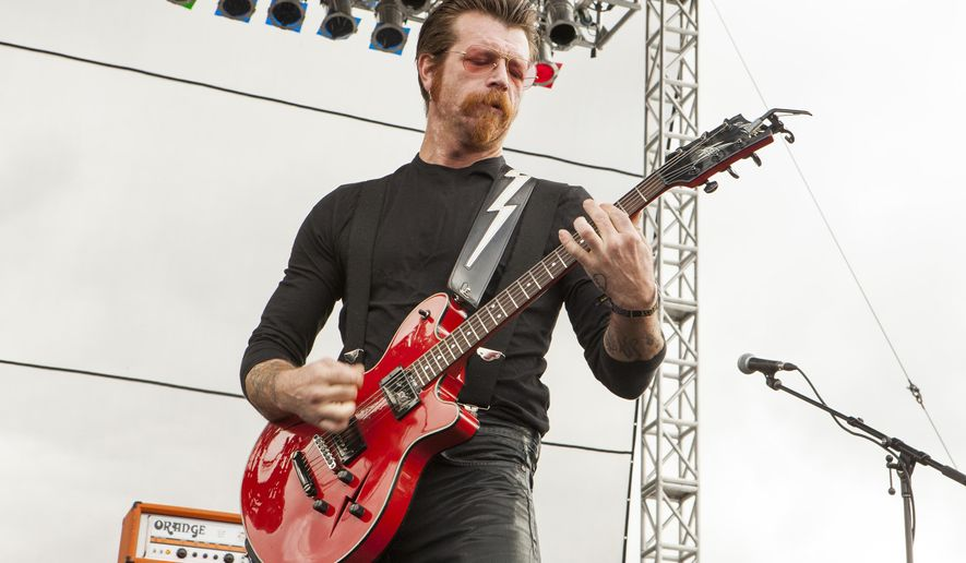 FILE - In this Sept. 11, 2015 file photo, Jesse Hughes of Eagles of Death Metal performs at Riot Fest & Carnival in Chicago. The U.S. rock band Eagles of Death Metal have announced dates for a rescheduled European tour, including a return to Paris. The band was in the middle of performing at the Bataclan in Paris on Nov. 13 when 130 people were killed in the city. The band will play the Olympia Theatre in Paris on Feb. 16, 2016. (Photo by Barry Brecheisen/Invision/AP, File)