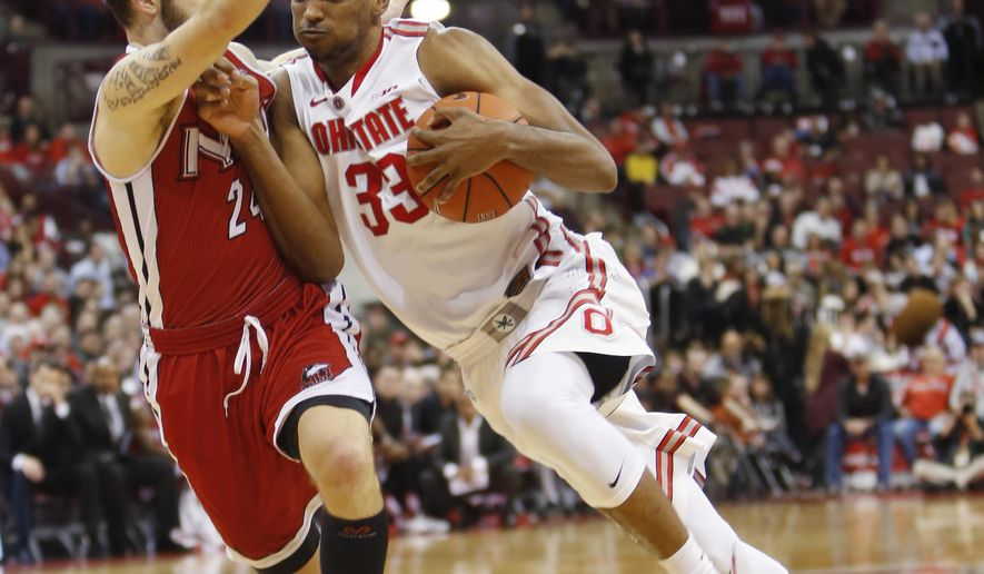 Ohio State's Keita Bates-Diop, right, drives to the basket against Northern Illinois' Michael Orris during the second half of an NCAA college basketball game Wednesday, Dec. 16, 2015, in Columbus, Ohio. Ohio State beat Northern Illinois 67-54. (AP Photo/Jay LaPrete)