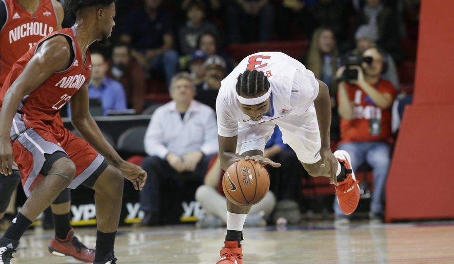 SMU guard Sterling Brown (3) takes control of the ball in front of Nicholls State guard T.J. Carpenter (22)  during the first half of an NCAA college basketball game Wednesday, Dec. 16, 2015, in Dallas. (AP Photo/LM Otero)
